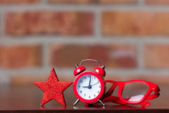 Retro alarm clock and star with glasses Stock Photo