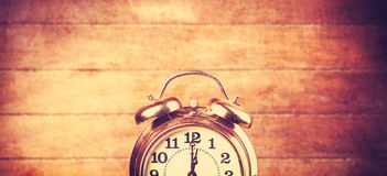 Retro alarm clock on a table Stock Images