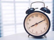 Retro alarm clock on table Stock Images