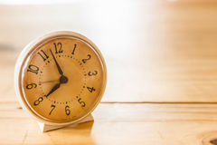 Retro alarm clock on table Stock Photography