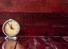 Retro alarm clock on table Royalty Free Stock Photography