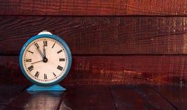 Retro alarm clock on table Royalty Free Stock Image