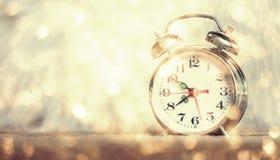 Retro alarm clock on table Stock Image