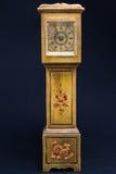 Retro alarm clock tower shaped on black background Royalty Free Stock Photo