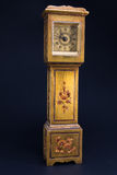 Retro alarm clock tower shaped on black background Royalty Free Stock Photography