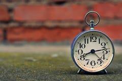 Retro alarm clock with vintage efect Stock Images
