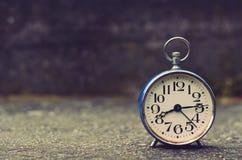 Retro alarm clock with vintage efect Stock Photo