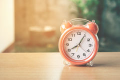Retro alarm clock. vintage style filtered photo Royalty Free Stock Photo