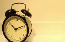 Retro alarm clock in the warm light, with free space for design Stock Image