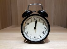 Retro alarm clock on wooden cabinet Stock Image