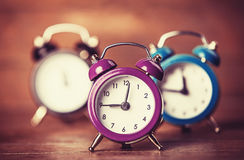 Retro alarm clocks on a table. Royalty Free Stock Images