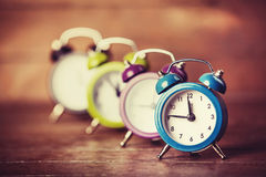 Retro alarm clocks on a table. Stock Image