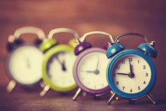 Retro alarm clocks on a table. Stock Photography