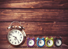 Retro alarm clocks on a table Stock Images