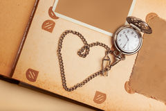 Retro album page with vintage clock with chain Stock Photography