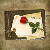 Retro album with rose on the brown background Royalty Free Stock Photography