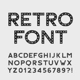 Retro alphabet font. Scratched type letters and numbers. Stock Image