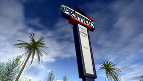 Retro american sign of a motel. A 3D rendered image of a classic model motel billboard. A high retro designed sign in front of a sunny blue sky with some palm Royalty Free Stock Image