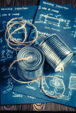 Retro analog telephone made of string and cans. On old wooden table Royalty Free Stock Photo