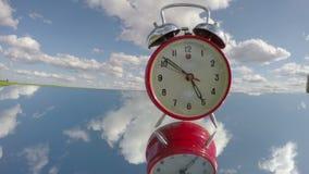 Retro analogue alarm clock on mirror and arrow motion. Timelapse 4K stock footage