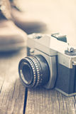 Retro analogue camera on old wooden table Royalty Free Stock Photos