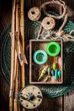 Retro angler equipment with fishing flies and rods Royalty Free Stock Images
