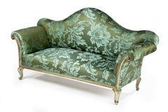 Retro antigo brilhante do sofá pintado com porca jovem Fotografia de Stock