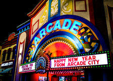Retro Arcade Front. Brightly lit vintage arcade sign in shining in the dark Stock Image