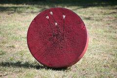 Retro archery target with arrows Stock Images