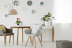 Free Retro Armchairs, Table, Chandelier, Ceramic Wall Decoration And Royalty Free Stock Photography - 116944037