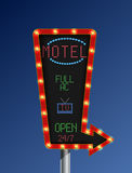 Retro arrow golden light banner with the motel blue background Stock Images