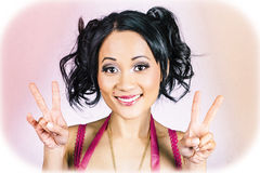 Retro asian girl gesturing peace love and hope Royalty Free Stock Images