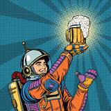 Retro astronaut and a mug of beer Stock Photography
