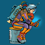 Retro astronaut with a smartphone. Pop art retro style. Thinker. Science fiction. Technologies and gadgets. Mobile phone. Internet and communications Royalty Free Stock Images