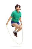 Retro athlete exercising with a jump rope Stock Photos