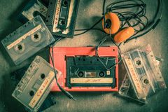 Retro audio cassette with headphones and red walkman royalty free stock image
