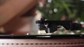 Close-up shot of a turntable stylus reaching the end of a retro style recording. selective focus