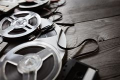 Old audio reels and cassette tape background Stock Photo