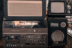 Retro audio system with radio, cassette tape recorder. Old vintage audio system with radio, cassette tape recorder, record player, TV set, acoustic speakers royalty free stock photos