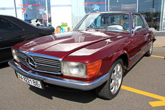Retro auto show. Red Mercedes-Benz 350 SLC Royalty Free Stock Photography