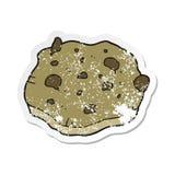 retro autoadesivo afflitto di un biscotto di pepita di cioccolato del fumetto royalty illustrazione gratis