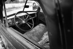 Retro Automobile drivers seat and steering wheel Royalty Free Stock Photography
