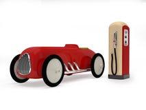 Retro automobile e stazione di servizio del giocattolo Fotografia Stock