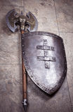 Retro axe and shield. Full view of vintage axe with shield Royalty Free Stock Images