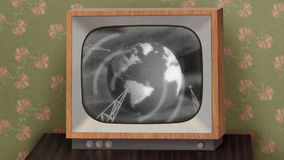 Retro b&w TV set. Retro b&w TV set showing news intro before switching to green (chroma key) background, then switching to TV test and finally switching off stock footage