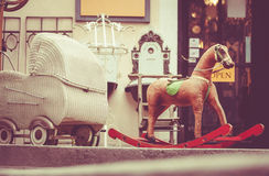 Retro baby carriage and toy rocking-horse Stock Images