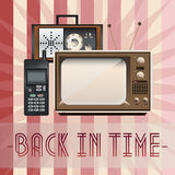 Retro, back in time. Retro background with old fashioned TV, phone and radio and with inscription back in time Stock Photo