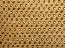 Retro background. An old book inner cover paper page with golden print. Retro background type Royalty Free Stock Photography