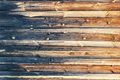 Retro background of boards logs burned on one side. Old wooden background