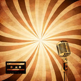 Retro music background. Retro background cassette and microphone Stock Photography